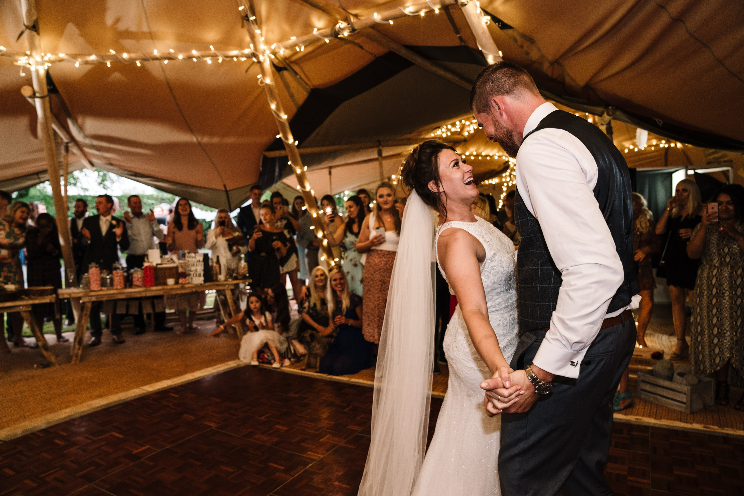 bride and groom dancing at their tipi wedding