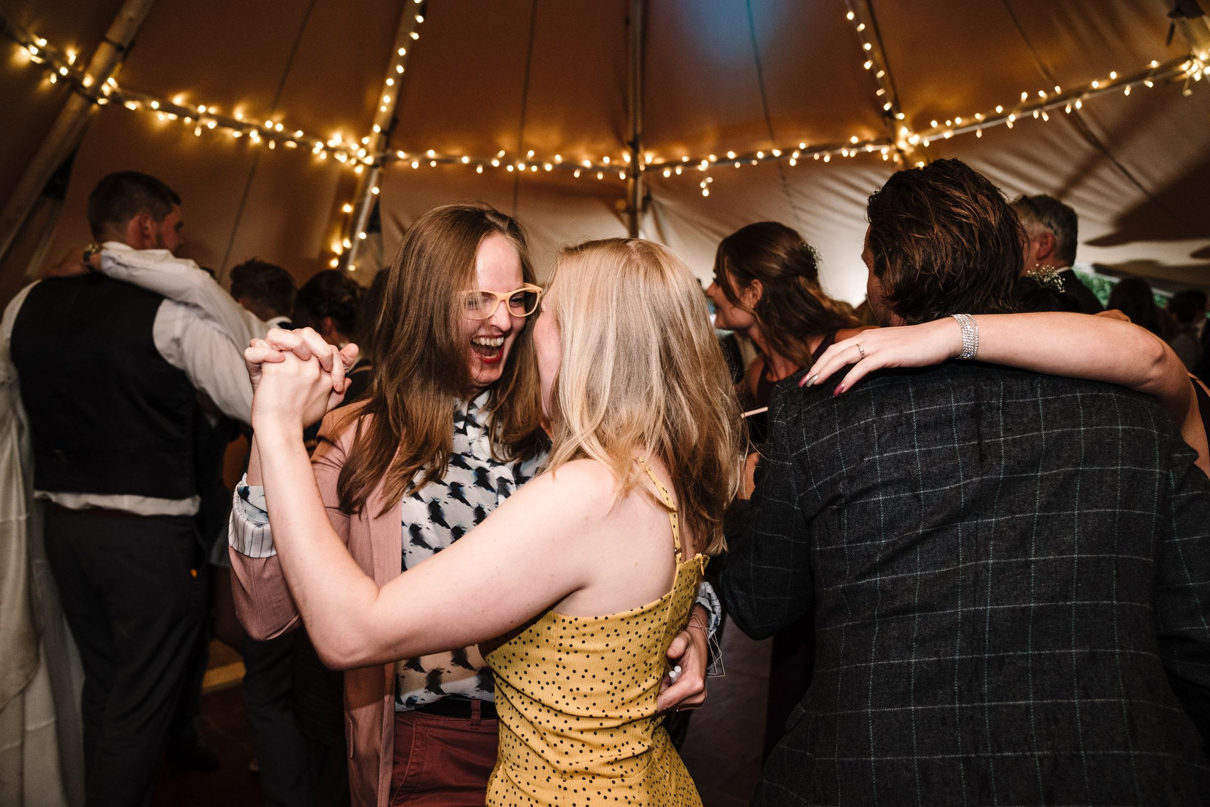 girls dancing at tipi wedding