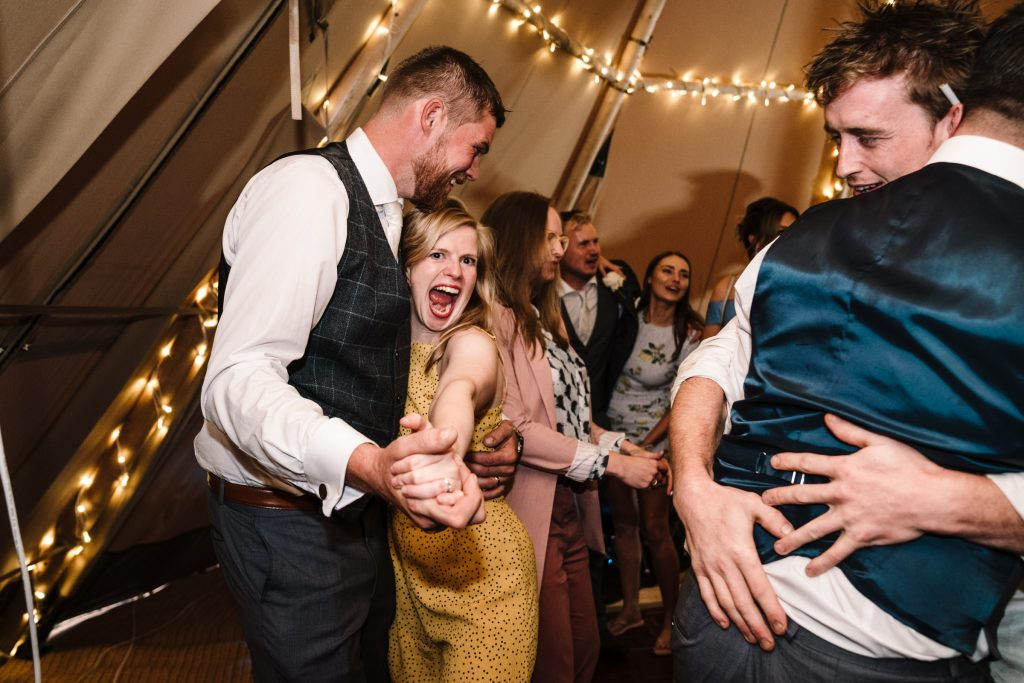 guests dancing at tipi wedding, warwickshire