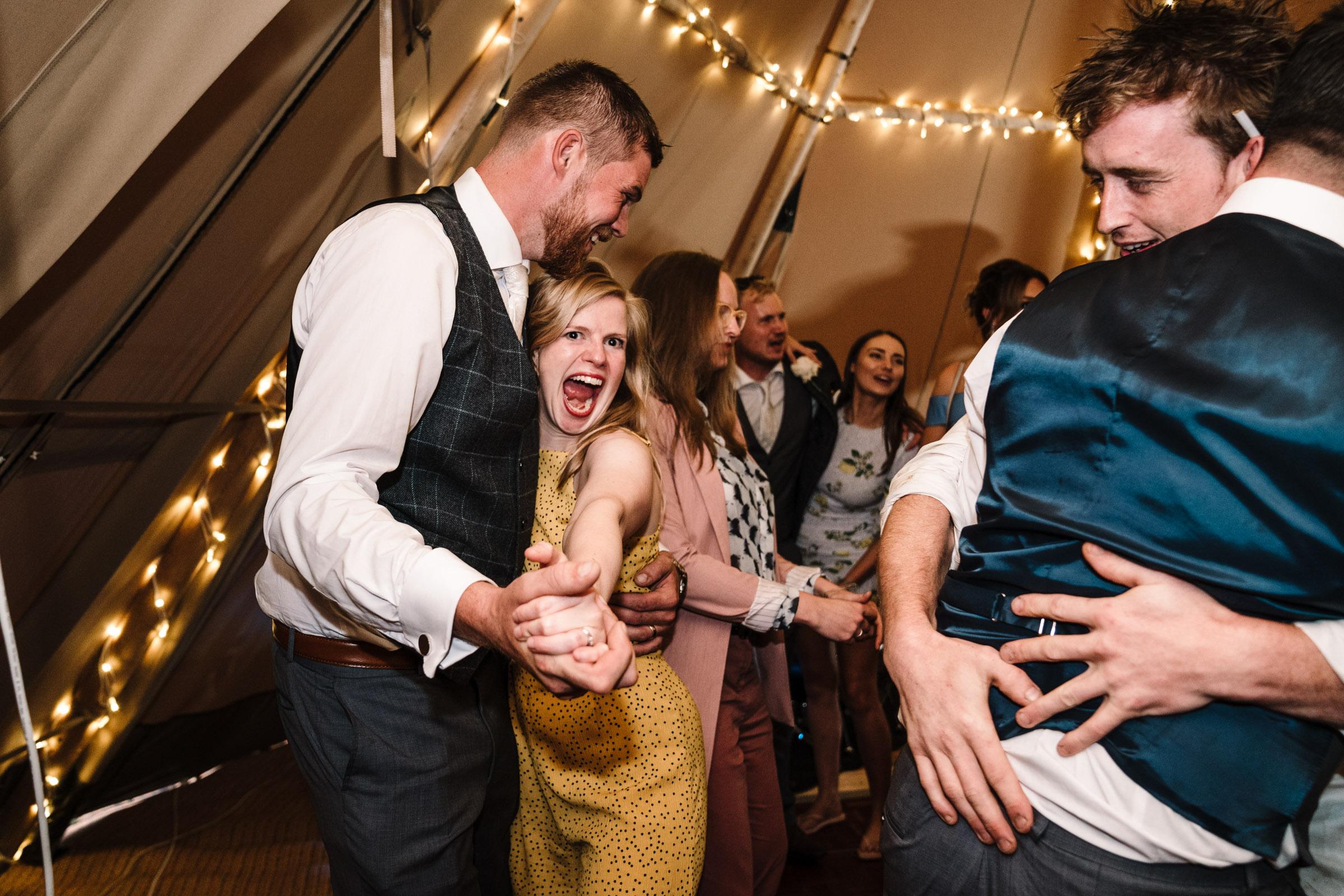 guests dancing at tipi wedding, warwickshire