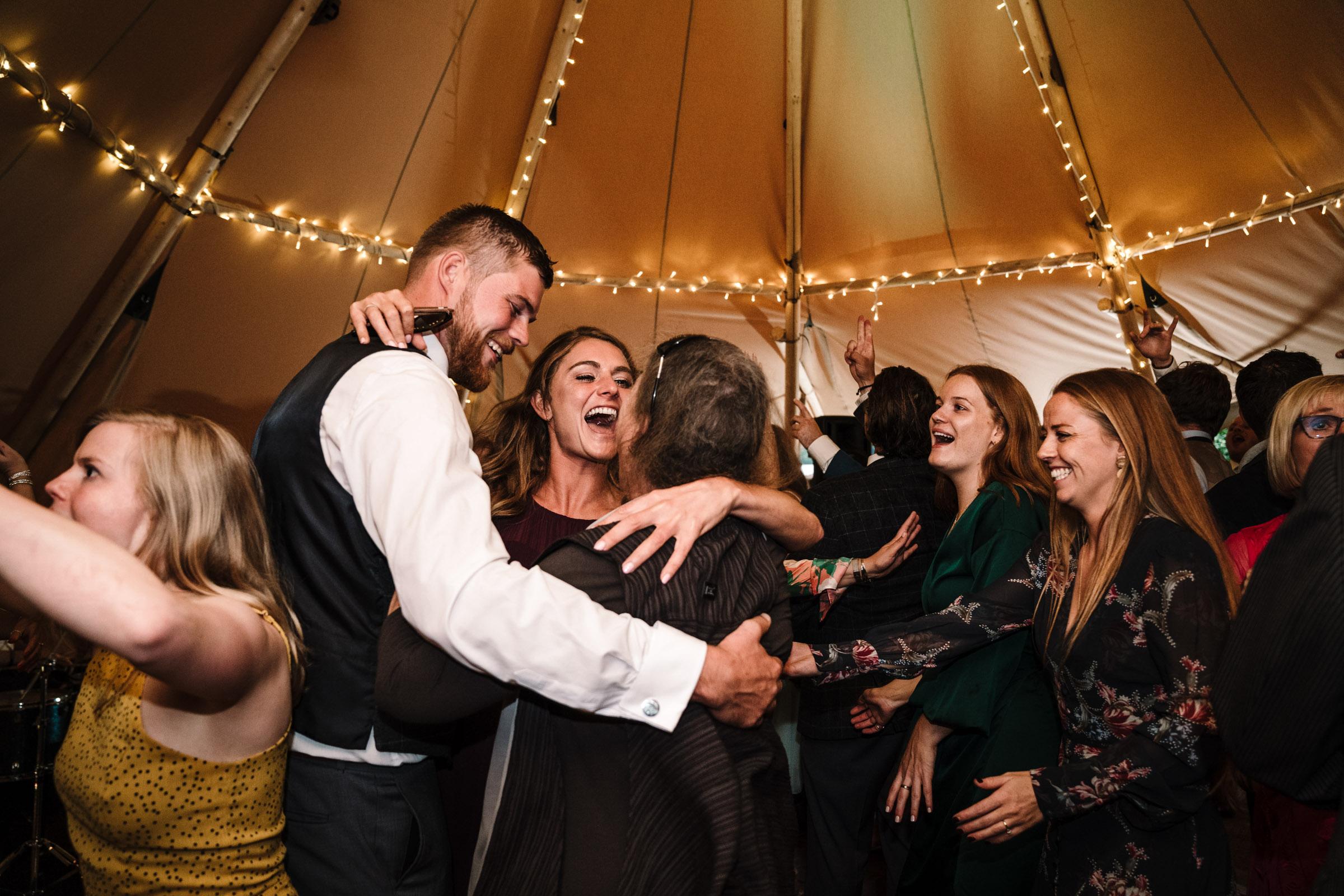 guests dancing at tipi wedding