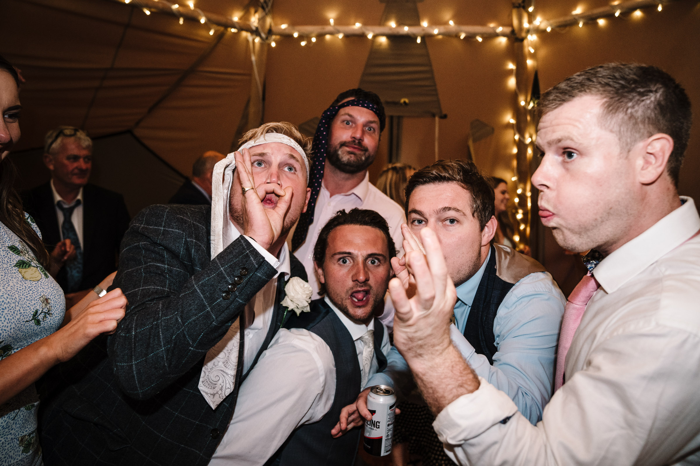 guests dancing at wedding with ties round their heads