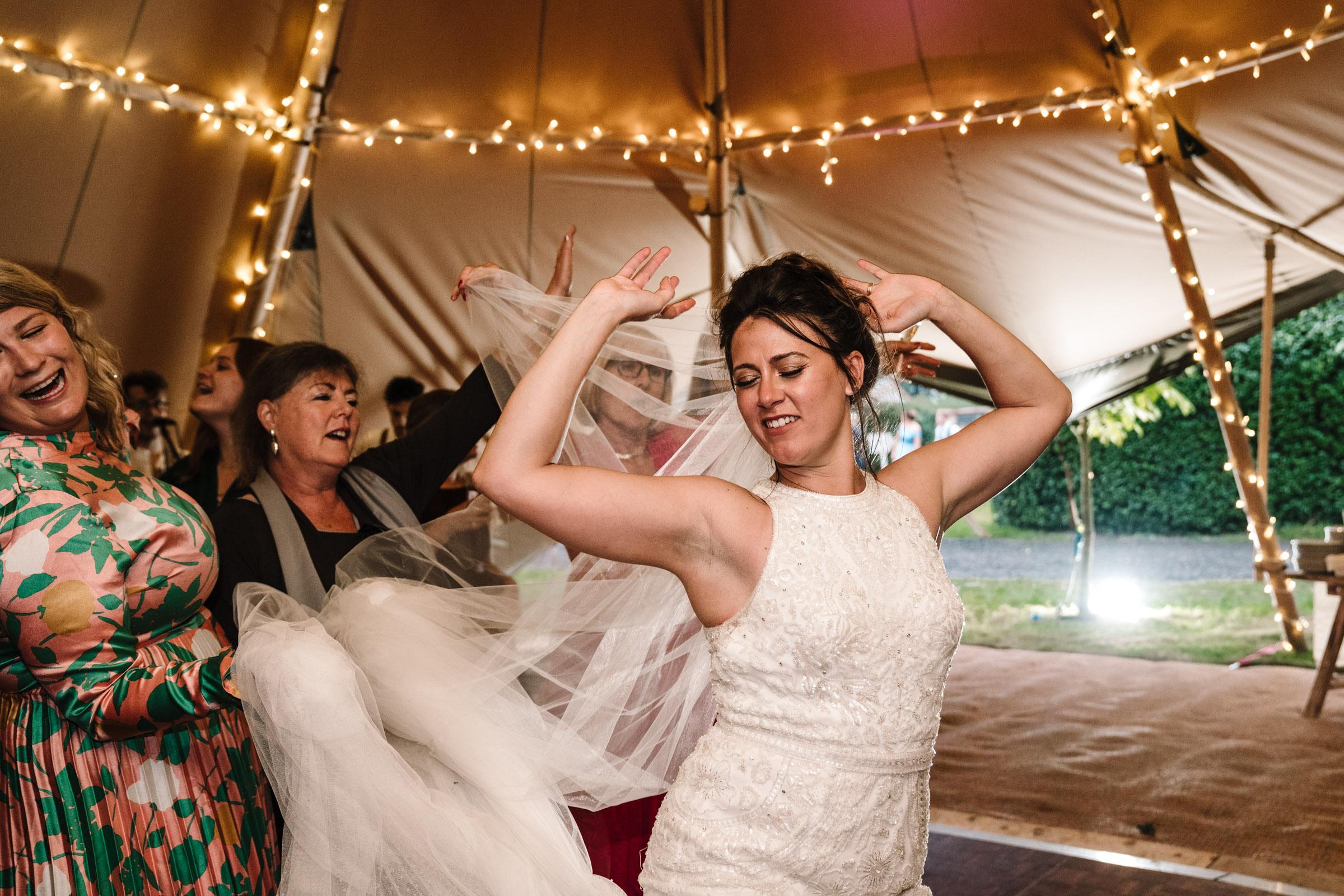 Bride dancing on the dancefloor at wedding