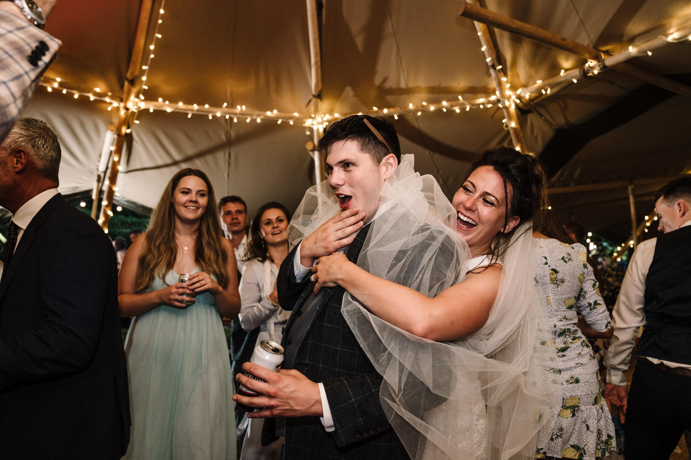 tipi wedding, bride and guests dancing on dancefloor