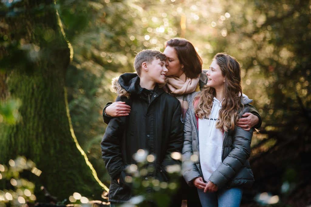Mum kissing her son and cuddling her daughter in solihull Family photoshoot
