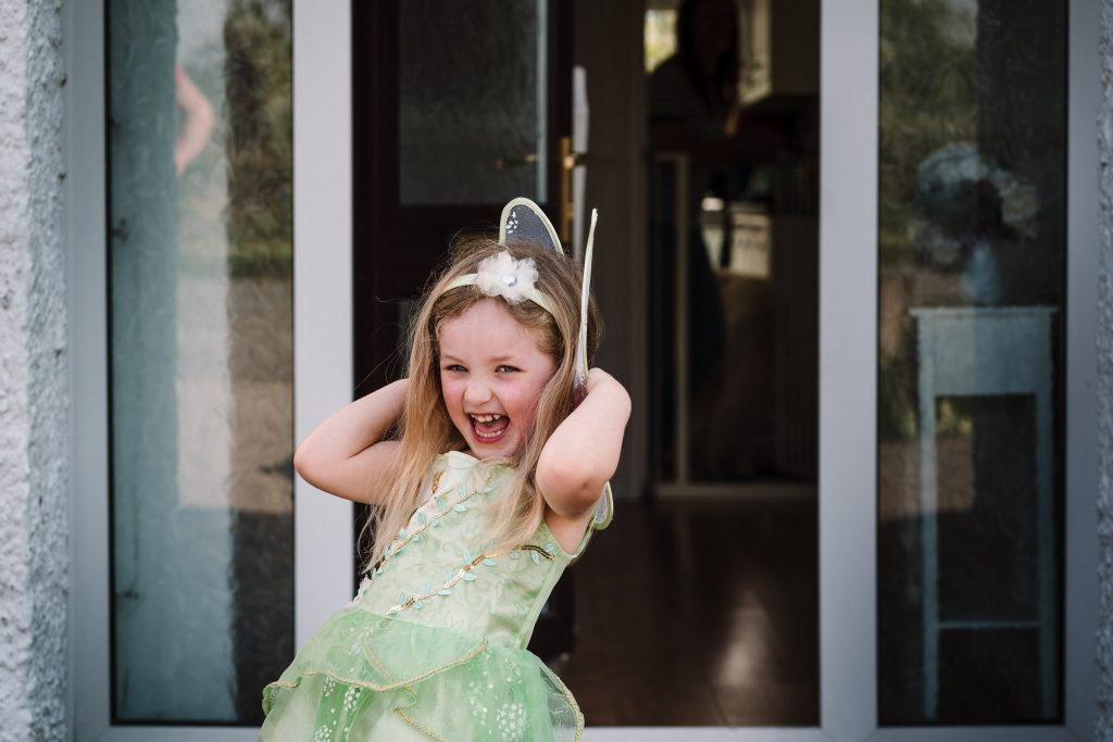 Little girl dressed up as tinkerbell laughing