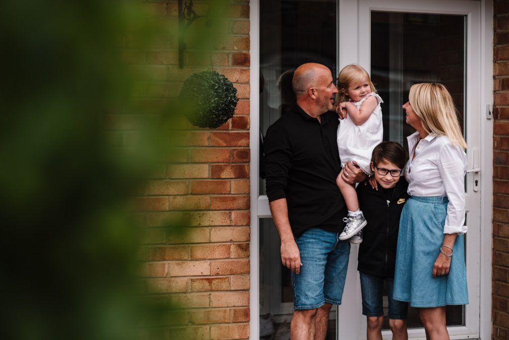 Family on front door step- doorstep photo shoot
