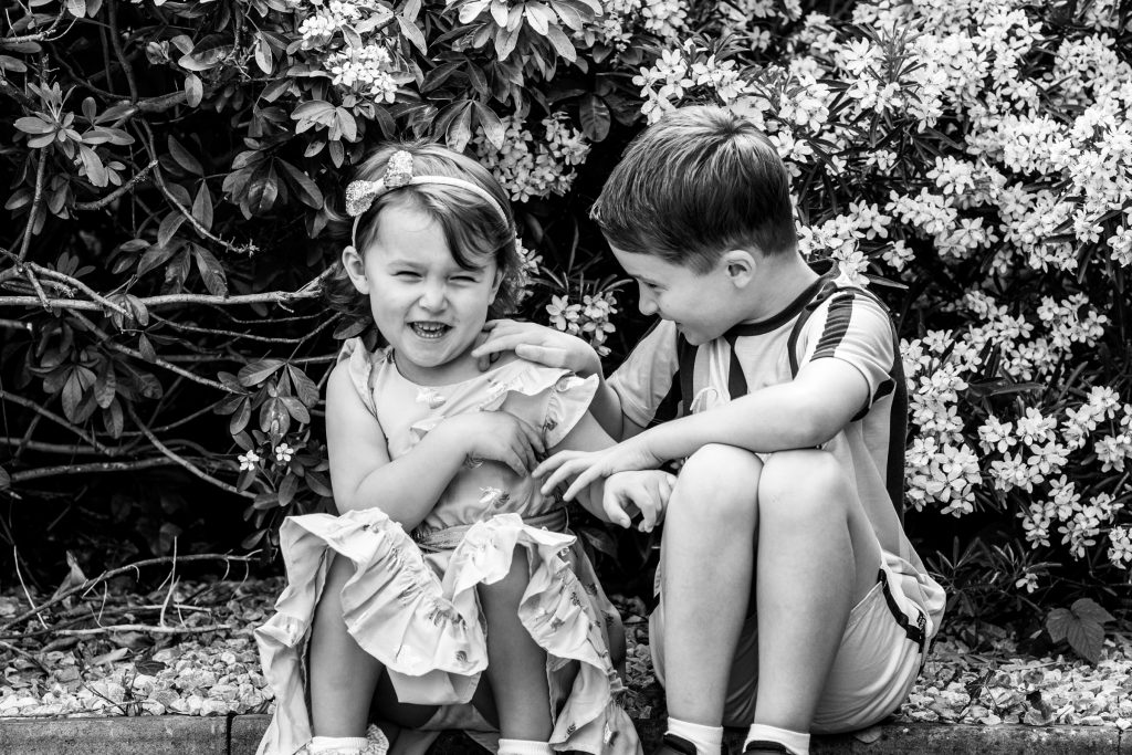 brother tickling sister, doorstep photo shoot