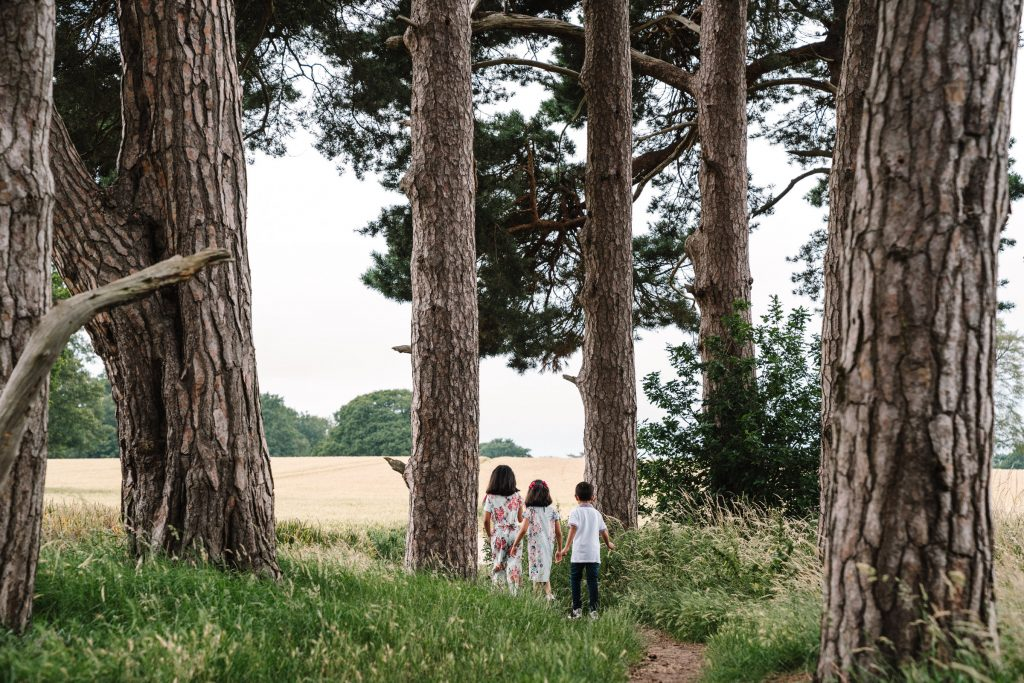 children walking through trees, outdoor family photography