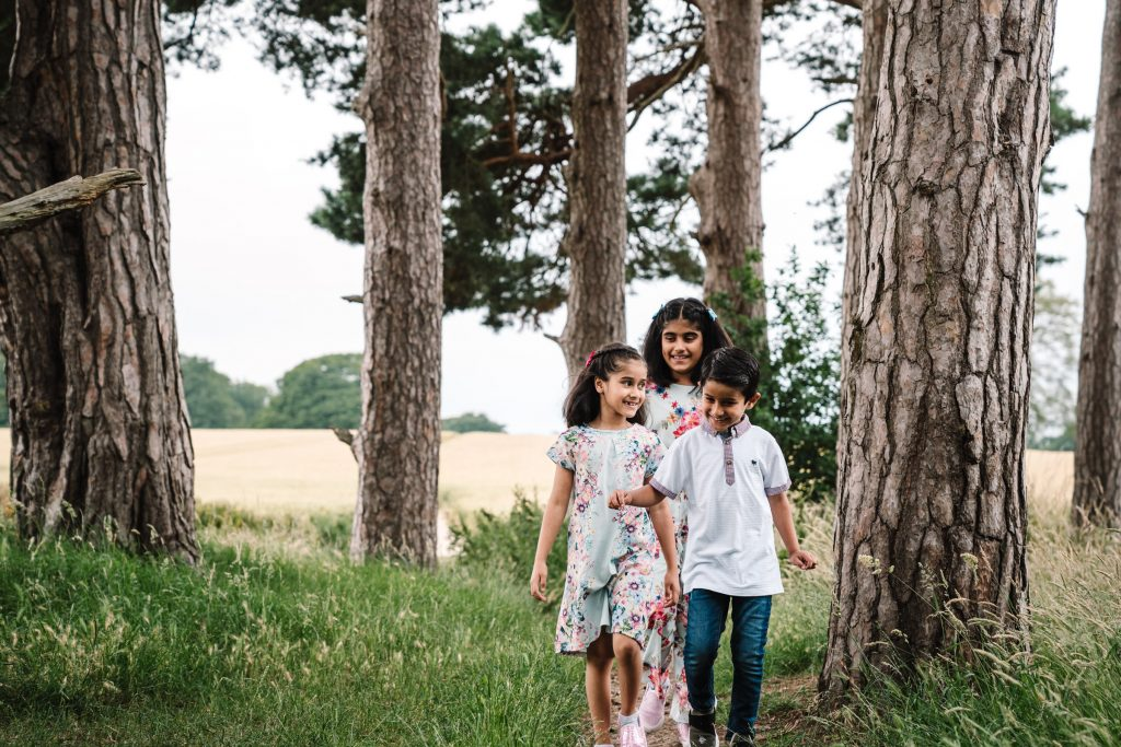 children walking through trees, outdoor family shoot