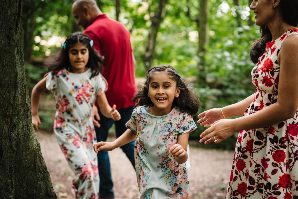 children running and playing during outdoor family photgraphy