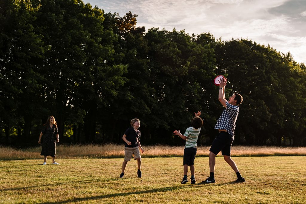 Family playing with a frisbee in Newbold Comyn