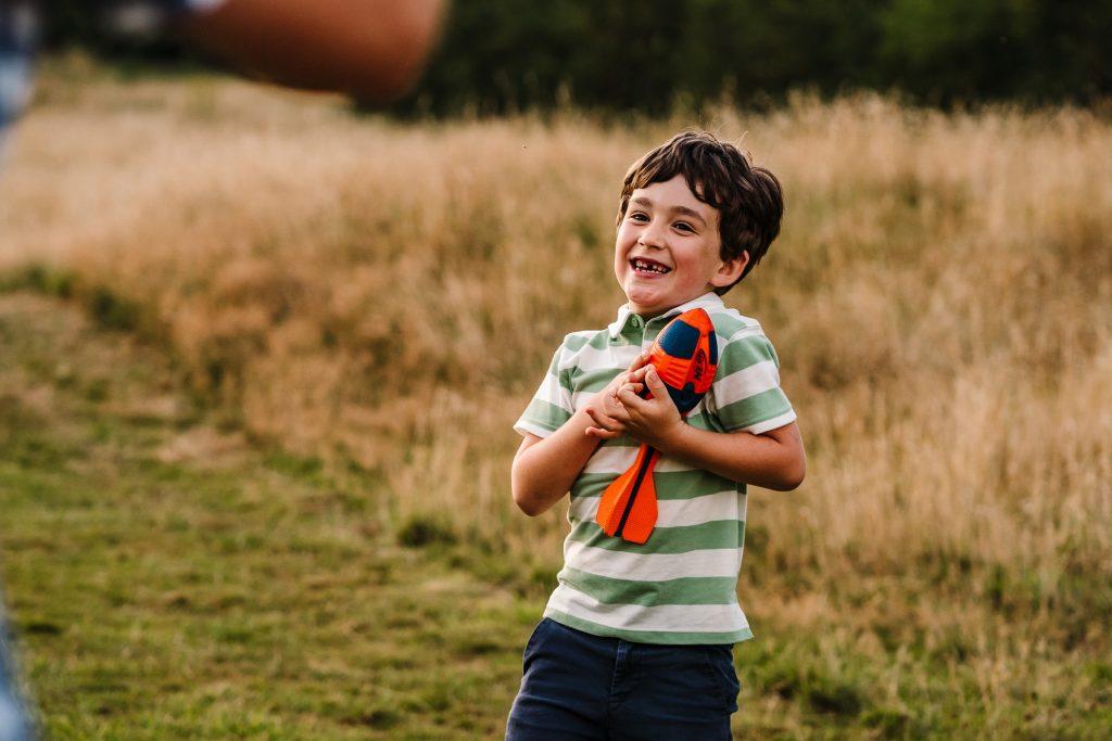Boy catching a ball at Newbold Comyn, Warwickshire