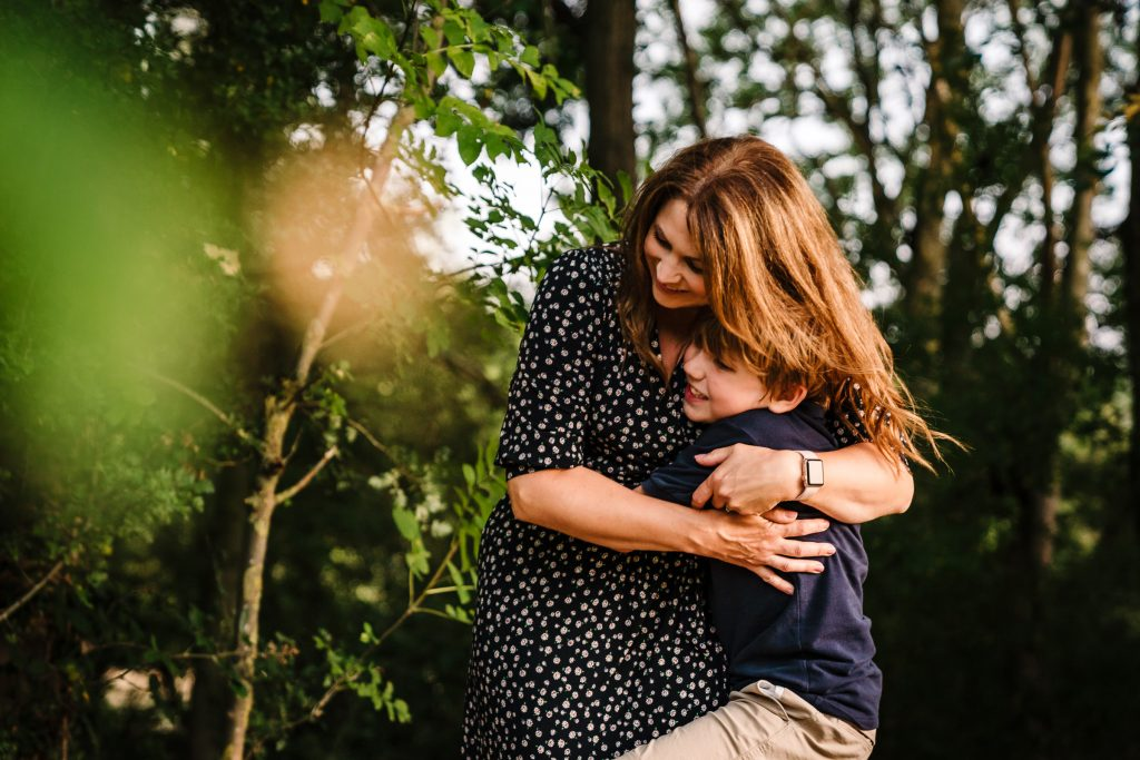 Mum cuddling her son