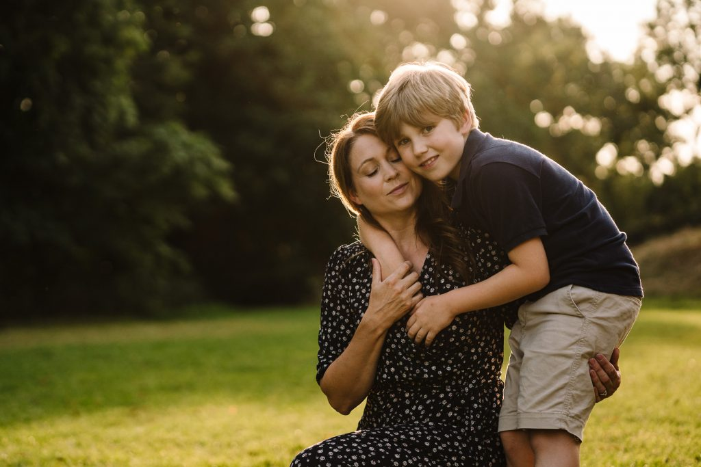 Mum cuddling her son - family photographer