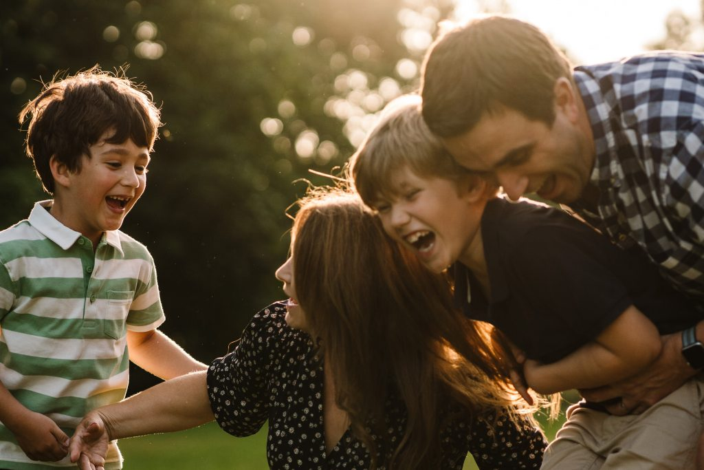 A family laughing and tickling each other
