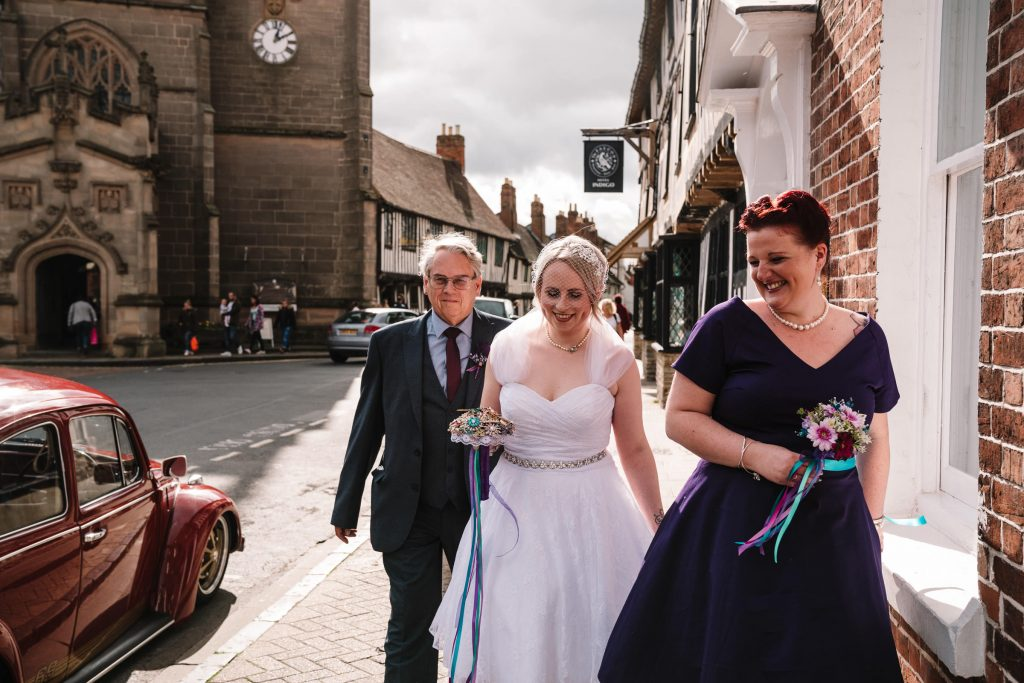 bride bridesmaid and dad walking to stratford wedding at the town hall
