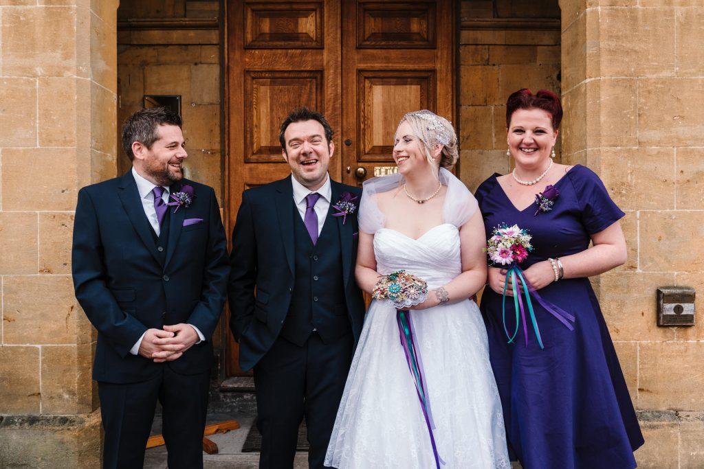 bride, Groom, bridesmaid and best man posing for a photograph