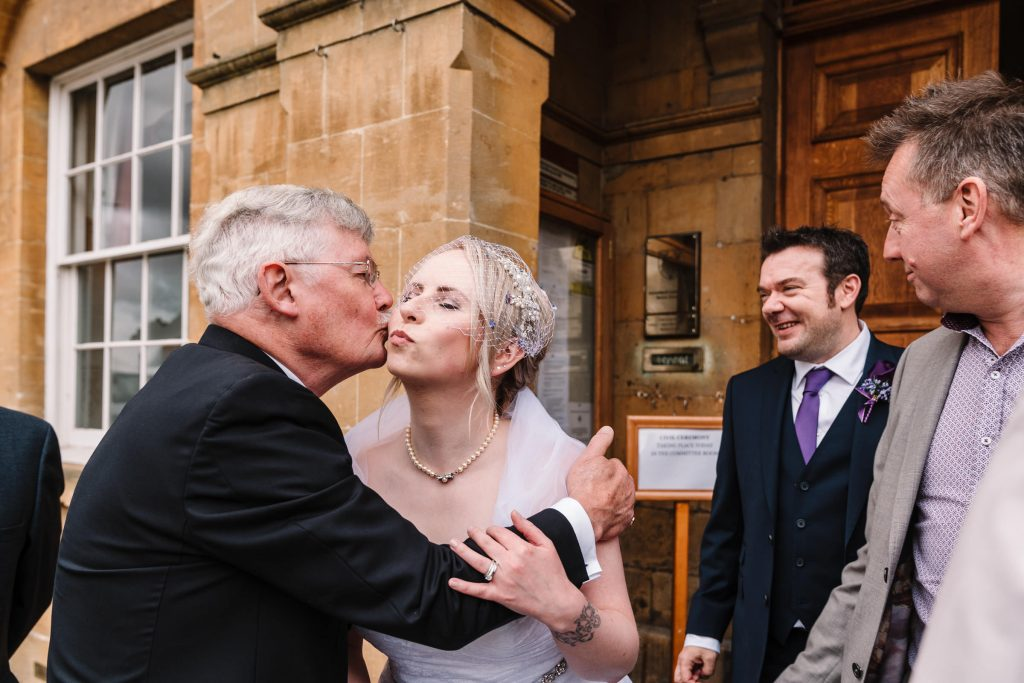 guests congratulating the bride in Stratford outside the town hall