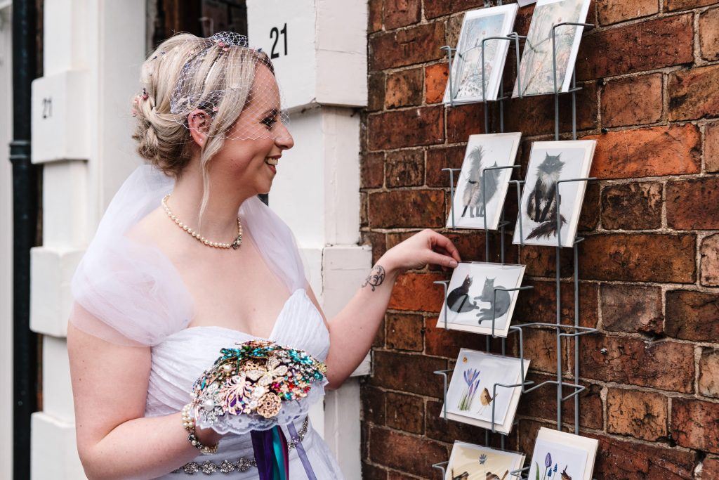 bride looking at cat postcards in Stratford