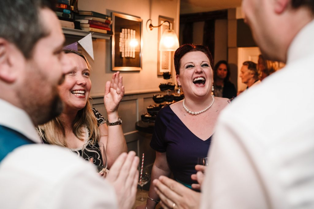 guests laughing at Stratford Wedding
