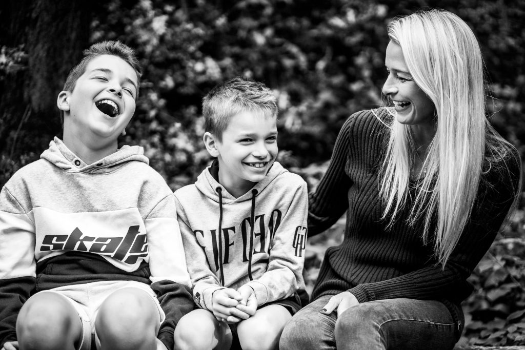 Mum and her two sons laughing during family photography session