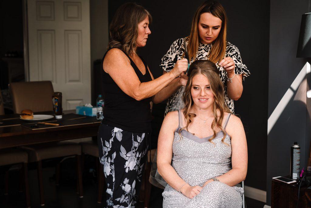 bridal prep, bride having veil fitted in hair